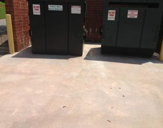 Power washed dumpster pad